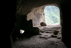 Georgia 18 June 2016: The 12th century Cave Town of Vardzia, a cave monastery site in southern Georgia, excavated from the slopes of the Erusheti Mountain on the left bank of the Kura River, thirty kilometres from Aspindza. The area has been submitted for future inscription on the UNESCO World Heritage List.