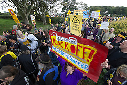 © Licensed to London News Pictures . 08/10/2016 . Lancashire , UK . Demonstrators at the gate to farmland on Preston New Road on which the permission to frack has been granted . Anti fracking demonstration against the government and fracking firm Cuadrilla at Maple Farm on Preston New Road near Preston in Lancashire , following Communities and Local Government Minister Sajid Javid's decision to overturn Lancashire County Council's decision to ban fracking on the site . Photo credit : Joel Goodman/LNP