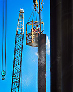 Photographie pour un reportage industriel réalisé pour Koniambo Nickel SAS lors du remplissage des pieux du port en eaux profonde de Vavouto.