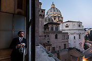 Rome, Vatican Museums, Giovanni Crea opening the window early in the morning, his shift starts at 5.30 am, view of St. Peter from the Cappella Di S. Pio V