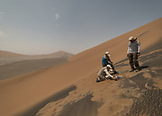 Team of botanist and hydologists getting ground temperature. During this expedition, the team measured an incredible surface temperature of 78.2°C (172.7°F).
