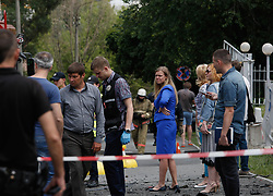 June 27, 2017 - Kyiv, Ukraine - Forensic police experts and military intelligence examine the wreckage of a car in Kyiv. The commander of Ukraine's military intelligence special ops unit colonel Maksym Shapoval was killed by a bomb attached to the bottom of his vehicle in central Kyiv. Police investigate the incident as an ''act of terrorism' (Credit Image: © Sergii Kharchenko/Pacific Press via ZUMA Wire)