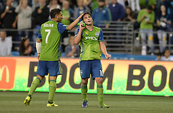 September 27, 2017 - Seattle, WASHINGTON, U.S - Sounders midfielder NICHOLAS LODEIRO (10) celebrates his goal against Vancouver with CHRISTIAN ROLDAN (7) as the Whitecaps visit the Seattle Sounders for an MLS match at Century Link Field in Seattle, WA. The Sounders won the match 3-0. (Credit Image: © Jeff Halstead via ZUMA Wire)