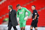 A disappointed Doncaster Rovers goalkeeper Marko Marosi (13) complains vision problems and subsequently has to be substituted for Doncaster Rovers goalkeeper Ross Etheridge (1)  during the EFL Sky Bet League 2 match between Doncaster Rovers and Hartlepool United at the Keepmoat Stadium, Doncaster, England on 19 November 2016. Photo by Simon Davies.