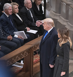United States President Donald J. Trump and first lady Melania Trump walk past former US President Bill Clinton, former US Secretary of State Hillary Rodham Clinton, and former US President Jimmy Carter, as they arrive for the National funeral service in honor of the late former United States President George H.W. Bush at the Washington National Cathedral in Washington, DC on Wednesday, December 5, 2018.<br /> Photo by Ron Sachs / CNP/ABACAPRESS.COM