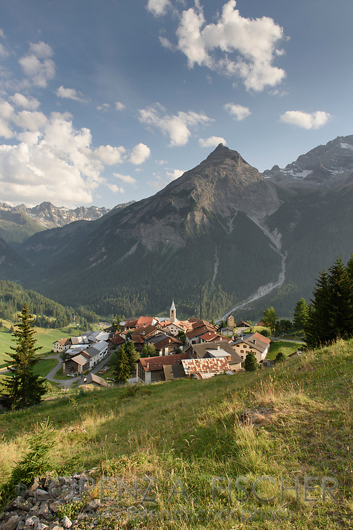 The small village Latsch in the Eastern Alps of Switzerland and the Piz Rugnux, Parc Ela, Grisons
