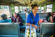 07 JANUARY 2013 - KANCHANABURI, THAILAND:   A food vendor walks through a third class train car on the train between Bangkok (Thonburi station) and Kanchanaburi. Thailand has a very advanced rail system and trains reach all parts of the country.    PHOTO BY JACK KURTZ