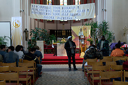 GHENT, BELGIUM - APRIL-18-2006 - Asylum seekers take refuge in Saint Antoine Catholic Church in Ghent, Belgium. (PHOTO © JOCK FISTICK)