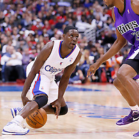 23 November 2013: Los Angeles Clippers point guard Darren Collison (2) makes a crossover move against Sacramento Kings small forward Travis Outlaw (25) during the Los Angeles Clippers 103-102 victory over the Sacramento Kings at the Staples Center, Los Angeles, California, USA.
