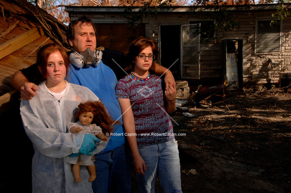 """""""We evacuated the day of the hurricane and couldn't take all of the pets. We lost the yellow lab, along with one of the cats...Everything's destrroyed and we're just going to have to decide how to put parts of our lives back together.  Eldon Silva and his daughters Mary, left, 13, and Adele, 15 lost a dog, cat, and their entire home in St. Bernard's Parish to the floods following Hurricane Katrina, and now are living in Georgia until they know what's next. Thursday, Nov. 3, 2005."""