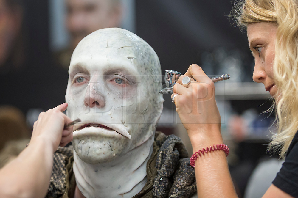 © Licensed to London News Pictures. 18/05/2019. LONDON, UK. Make-up artists at work at the International Make-Up Artists Trade Show (IMATS) taking place at Kensington Olympia 16 to 19 May 2019.  The show brings together make-up artists from around the world, including those with Hollywood movie backgrounds, providing classes in theatre, film, TV, fashion and editorial make-up to professionals and enthusiasts.  Photo credit: Stephen Chung/LNP