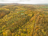 Aerial panoramic view of rural village in autumnal forest, Blatusa, Croatia.