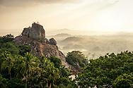 Sunrise in Mihintale, Sri Lanka. <br /> View of Aradhana Gala rock and the landscape