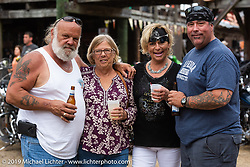 Big Steve with his wife and friends at the Iron Horse Saloon during Daytona Bike Week. Ormond Beach, FL. USA. Sunday March 11, 2018. Photography ©2018 Michael Lichter.