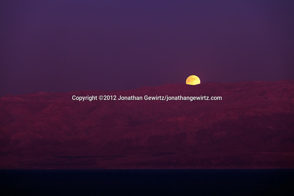 The full Moon rises over the Mountains of Moab as seen from the Israeli Dead Sea coast. WATERMARKS WILL NOT APPEAR ON PRINTS OR LICENSED IMAGES.