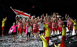 Jersey's flag bearer Dan Halksworth leads the team out during the Opening Ceremony for the 2018 Commonwealth Games at the Carrara Stadium in the Gold Coast, Australia.