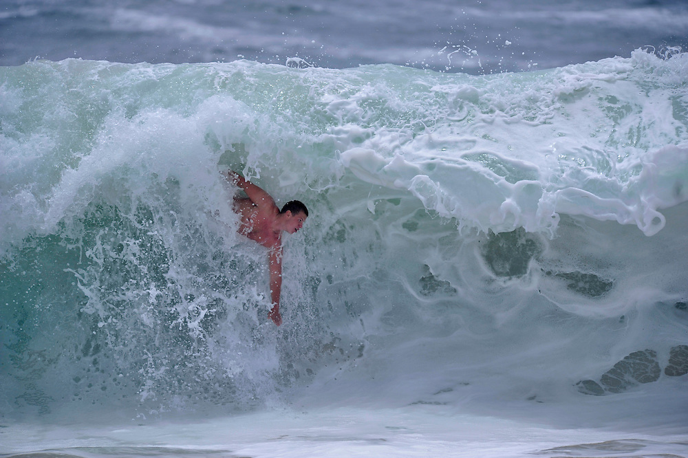 Nick Svendsen catches a wave at the wedge in Newport Beach Friday afternoon.  Waves were generally 4-5 feet, with some getting up to 6 feet.