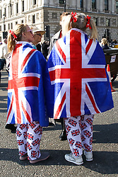March 29, 2019 - London, United Kingdom - A couple is seen outside House of Parliament wearing Union Jack trousers and wrapped in Union Jack flags during the protest..Leave campaigners protest against the delay to Brexit, on the day that UK was due to leave the European Union. British Prime Minister Theresa May's Brexit deal was defeated for a third time by a margin of 58 votes. (Credit Image: © Dinendra Haria/SOPA Images via ZUMA Wire)