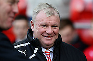 Rotherham Utd manager Steve Evans smiles before k/o. Skybet football league championship match, Cardiff city v Rotherham Utd at the Cardiff city stadium in Cardiff, South Wales on Saturday 6th December 2014<br /> pic by Mark Hawkins, Andrew Orchard sports photography.
