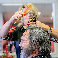 Stylist Clorinda Brito draws hair from Grants mayor Modie Hicks at Clo's Hair Design in Grants Thursday. Hicks had his hair cut after a fundraiser to benefit the Marine ROTC drill team trip to a national competition.
