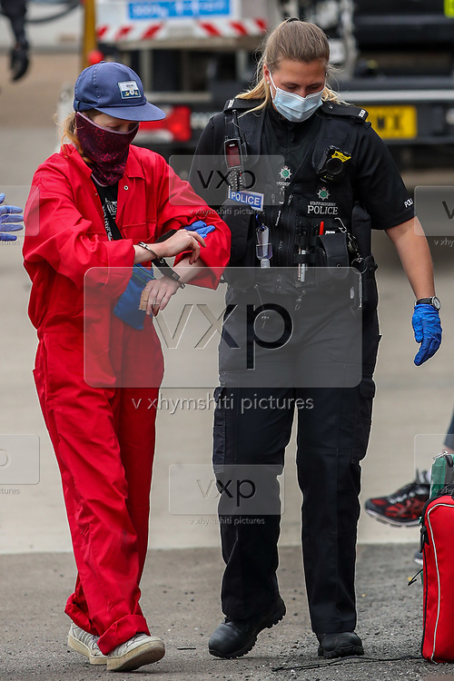 """Tamworth, United Kingdom, July 12, 2021: Police arrested two activists from the """"Palestine Action"""" activist group who scaled the roof, daubed blood-red paint and smashed the windows across the Elite KL site on Amington Industrial Estate in Tamworth early on Monday, July 12, 2021. Activists said that the brand is part of the Elbit company, which describes itself as a """"multi-domestic defence and electronics supplier"""". (VX Photo/ Vudi Xhymshiti)"""