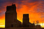 Grain elevators in ghost town at sunrise<br /> Lepine<br /> Saskatchewan<br /> Canada