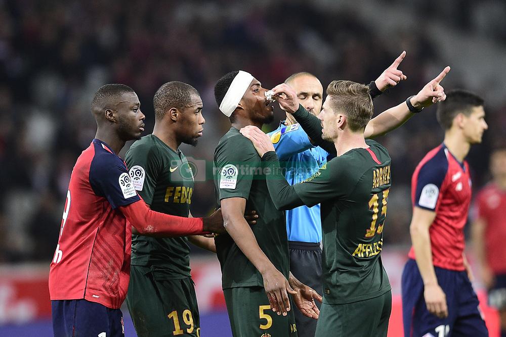 March 15, 2019 - Lille, France, FRANCE - blessure de JEMERSON (Monaco) raccompagne par Nicolas Pepe  (Credit Image: © Panoramic via ZUMA Press)