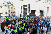 "Police form a line by Canada House after thet scuffled anti-vaxx protestors in Central London, on Saturday Sept 19, 2020 - after thousands gathered in London's Trafalgar Square from across the UK to protest against coronavirus restrictions and reject mass vaccinations. The event, which began at noon, drew a broad coalition including coronavirus sceptics, 5G conspiracy theorists and so-called ""anti-vaxxers"". Speakers at the event accused the government of attempting to curtail civil liberties. (VXP Photo/ Vudi Xhymshiti)"