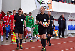 Referee Anastasios Papapetrou leads the players out before the UEFA Euro 2020 Qualifying, Group D match at the Victoria Stadium, Gibraltar.