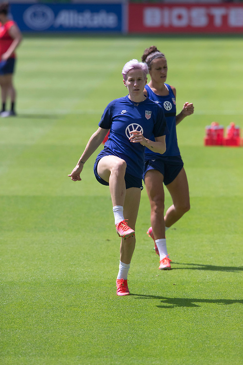 Forwards MEGAN RAPINOE , l, and CARLI LLOYD of the United States Women's National Team (USWNT) warm up at the new Q2 soccer stadium in Austin during one of the final games on their road to the 2021 Tokyo  Olympics. The team will play a friendly with Nigeria on Wednesday evening.