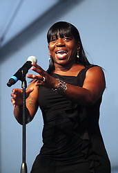 05 May 2012. New Orleans, Louisiana,  USA. .New Orleans Jazz and Heritage Festival. .Sandra Williams sings with Sharon Jones and the Dap-Kings..Photo; Charlie Varley.