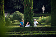 A woman reading a map in the Giardini Giusti, Verona, Italy<br /> The Giardino Giusti is one of the finest Renaissance gardens in Italy was laid out in 1580