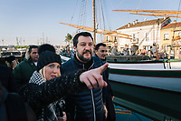 CESENATICO, ITALY - 5 JANUARY 2020: Matteo Salvini (center), former Interior Minister of Italy and leader of the far-right League party, visits the floating nativity scene during his campaign in Cesenatico, Italy, on January 5th 2020.<br /> <br /> Matteo Salvini is campaigning in the region of Emilia Romagna to support the League candidate Lucia Borgonzoni running for governor.<br /> <br /> After being ousted from government in September 2019, Matteo Salvini has made it a priority to campaign in all the Italian regions undergoing regional elections to demonstrate that, in power or not, he still commands considerable support.<br /> <br /> The January 26th regional elections in Emilia Romagna, traditionally the home of the Italian left, has been targeted by Matteo Salvini as a catalyst for bringing down the government. A loss for the center-left Democratic Party (PD) against Mr Salvini's right would strip the centre-left party of control of its symbolic heartland, and probably trigger a crisis in its coalition with the Five Star Movement.