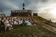 One Wednesday each month school meditation Brahma Kumar is an appointment for a collective session at Farol da Barra contemplating the sunset in an endless sea