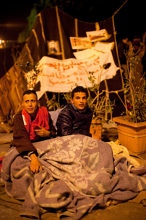 Tunis, Tunisia. January 26th 2011.Protesters are about to spend their third night (in defiance of a curfew) in front of the Prime Minister's office (Mohammed Ghannouchi) on the Kasbah Square. They demand the removal of Mohammed Ghannouchi and members of the ousted president's regime (Zine El Abidine Ben Ali) still in the the government. .....