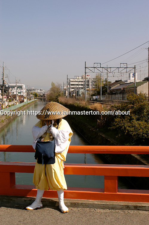 Monk collecting alms on the street in Kyoto Japan