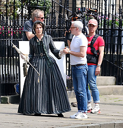 """Moray Place in Edinburgh's Georgian old town was turned into 19th century London for Julian Fellowes' new ITV show """"Belgravia"""".<br /> <br /> Pictured: Tamsin Greig (striped dress) talks to director John Alexander (white tee-shirt)<br /> <br /> Alex Todd 