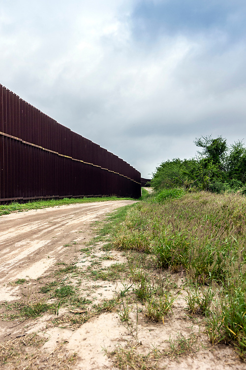A portion of the high steel border fence, Brownsville, Texas, USA.