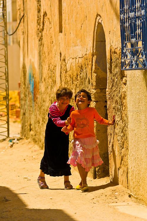 Girls playing in the street, Djerba Island, Tunisia