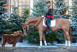 Sandro Pozzobon of the La Garde RŽpublicaine (right), French cavalry regiment with Shetland pony Bonnie, arrives at the Grand Hall entrance at Olympia London ahead of the start of the London International Horse Show.