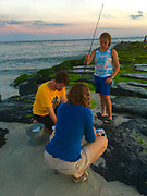 Ocean fishing preparation, mother father and daughter, Cape May Point jetty, Atlantic Ocean
