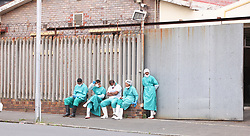 South Africa - Cape Town - 27 October 2020 - Workers at the Salt River Mortuary relaxes on the pavement during their break. Picture Leon Lestrade. African News Agency/ANA.