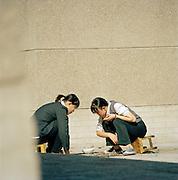 Girls playing a game in Jiayuguan, Gansu Province, China
