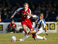 Photo: Chris Ratcliffe.<br />Colchester United v Southend United. Coca Cola League 1. 04/03/2006.<br />Luke Guttridge (L) of Southend gets away from Neil Danns of Colchester.
