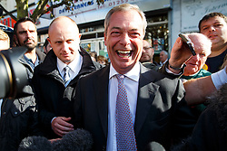 © Licensed to London News Pictures. 10/10/2014. Clacton, UK. UKIP leader Nigel Farage interviewed by a press pack in Clacton town centre on Friday, 10 October, 2014 after Douglas Carswell becomes the first ever MP of UKIP following the by-election of Clacton-on-Sea. Photo credit : Tolga Akmen/LNP