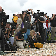 Members of the press take photos of the shuttle Atlantis as it sits on the pad after the rotating service structure is peeled away at the Kennedy Space Center Thursday, July 7, 2011, in Cape Canaveral, Fla. (AP Photo/Alex Menendez)