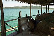 A man sleeps in a port in Koh Rong Island, Kingdom of Cambodia. PHOTO TIAGO MIRANDA