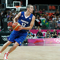 29 July 2012: Nando De Colo of Team France looks to pass the ball during the 98-71 Team USA victory over Team France, during the men's basketball preliminary, at the Basketball Arena, in London, Great Britain.