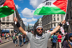London, August 9th 2014. A Protester, one of up to 150,000, awaits the beginning of the march from outside the BBC headquarters in Portland Place, to Hyde Park via the US embassy.