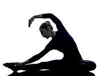 woman exercising Parivritta Janu Sirsasana Revolved Head of the Knee pose yoga silhouette shadow white background
